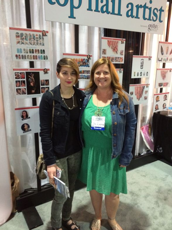 <p>Top 4 finisher in NAILS Next Top Nail Artist Julie Ventura (left) flew out from New York to attend the show and party. Here she is at the NAILS booth with editor Hannah Lee.</p>