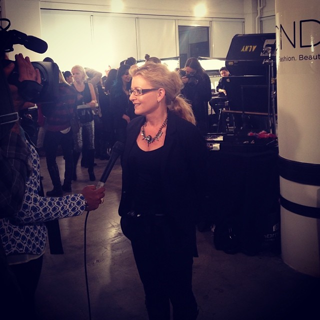"""<p class=""""author"""">CND international education manager Kristina Estabrooks is interviewed by the media. (Image via <a href=""""http://instagram.com/cndworld"""" target=""""_blank"""">@cndworld</a>)</p>"""