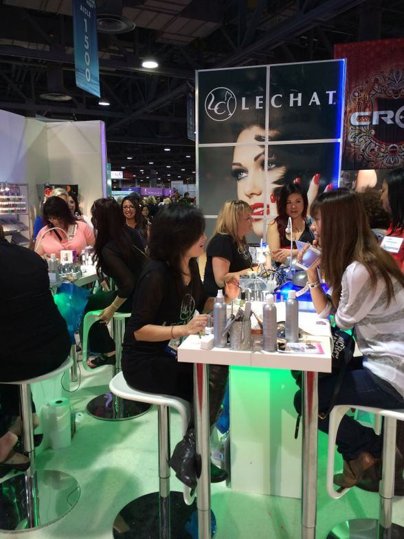 <p>Fun demo tables were the centerpiece of the LeChat booth.</p>