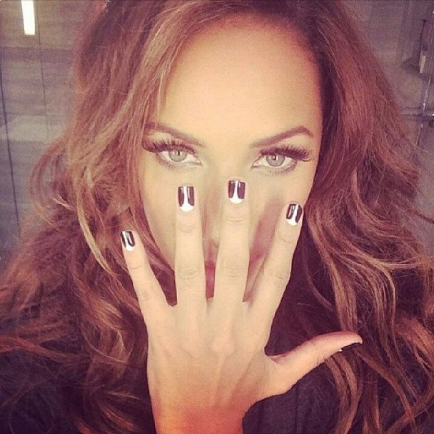 <p>Kimmie Kyees used Red Carpet Manicure's Black Stretch Limo and White Hot to create this haute manicure on Leona Lews for the Grammy Awards. Image via @kimmiekyees.</p>
