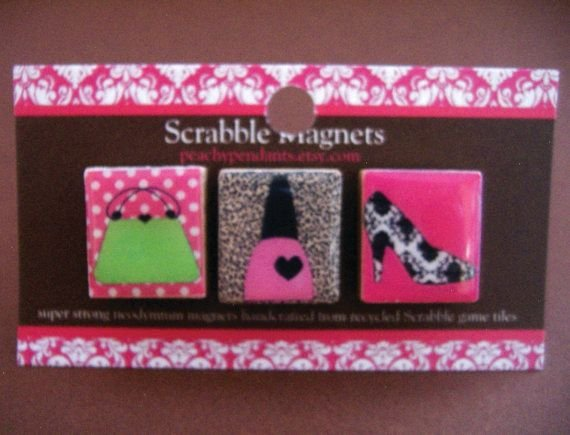<p>If you have a small refrigerator or magnetic surface in your salon, go the extra mile and add these magnets to accent your space. They are recycled Scrabble magnets and retail for only $12 at peachypendants.etsy.com.</p>