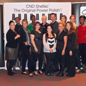 Birchall (front center, in the black and white) with the CND team at Beauty Buzz 2012 in Detroit.
