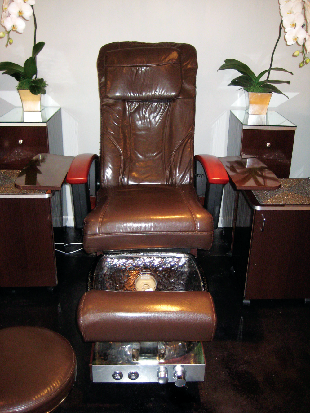 <p><strong>Camtu&rsquo;s Storage Solutions:&nbsp;</strong>All supplies at Blossom are concealed, making the entire salon aesthetically pleasing and organized. Instead of having baskets of exposed cuticle oil, acetone, cotton, and&nbsp;instruments (that could collect dust or look messy) Nguyen chose closed caddies for her storage. The pedi caddy shown here stores pedicure&nbsp;necessities; plus it doubles as a small table for the&nbsp;manicurist.</p>