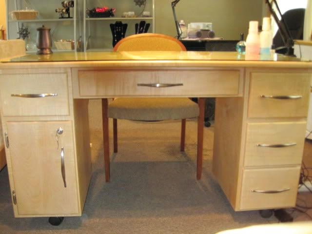 <p><strong>Colleen&rsquo;s Storage Solutions:&nbsp;</strong>The husband of a client built this custom-designed table for VanDurme. &ldquo;I needed more storage on my nail table and I really wanted a locking door,&rdquo; she says. Inside the drawers and behind the doors, product is organized in baskets.</p>