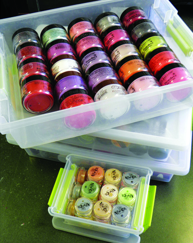 <p><strong>Maggie&rsquo;s Storage Solutions:</strong> &ldquo;The scrapbooking section at the local craft stores is a life saver!&rdquo; says Franklin. &ldquo;I like these little acrylic boxes that hold small jars for my rhinestones, clay cane slices, bits and pieces, and various doodads.&rdquo; Franklin says the small jars work well for glitter because the grooves for the lids have too much space and the glitter gets into the grooves, escapes the jars, and &ldquo;makes a big mess.&rdquo;</p>