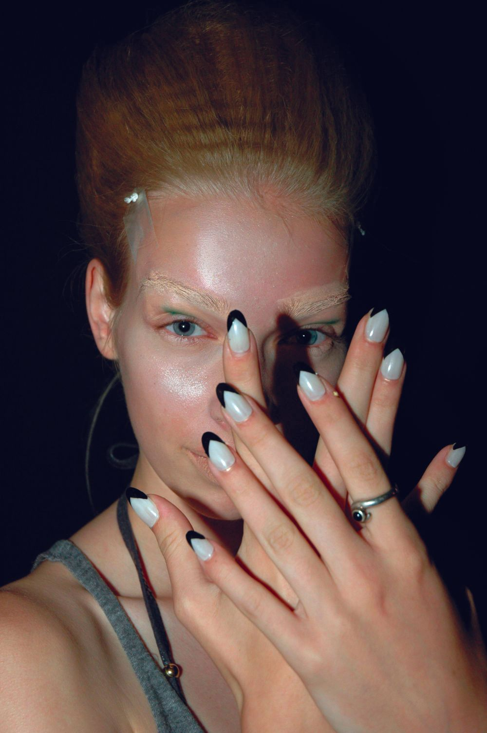 <p>Pattie Yankee created press-on nails for female models at the Jose Duran show using <strong>Dashing Diva</strong> The Met, a white polish, for a base, and Limo Service, a black polish, to create a chevron French. Male models were also given a similar manicure and pedicure to emulate the androgynous tone. (Photography by Ann Lawlor)</p>