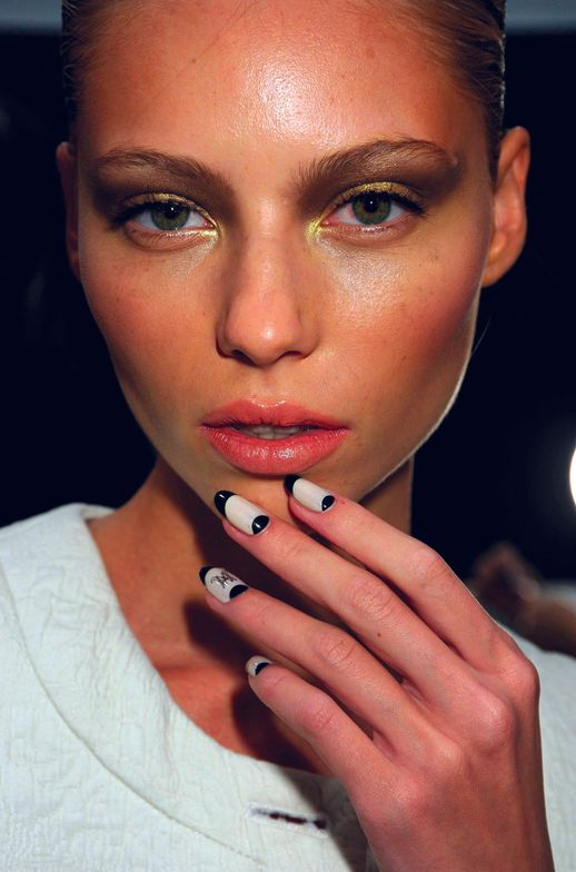 <p>For Ruffian, Amanda Fontanarrosa created a diplomatic and uniform-like &ldquo;monogram moon manicure&rdquo; with one coat of <strong>CND</strong> Putty plus one coat of Washed Down White, edged with Blackjack and topped with Air Dry to go with a French Foreign Legion, &rsquo;40s-inspired collection.</p>