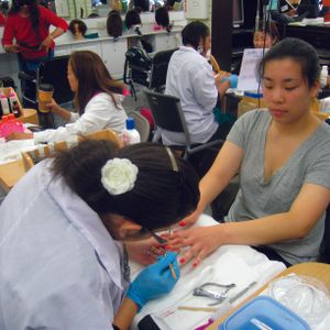 Supporters of the Healthy Nail Salon Recognition ordinance gave free manicures at a July 2010...