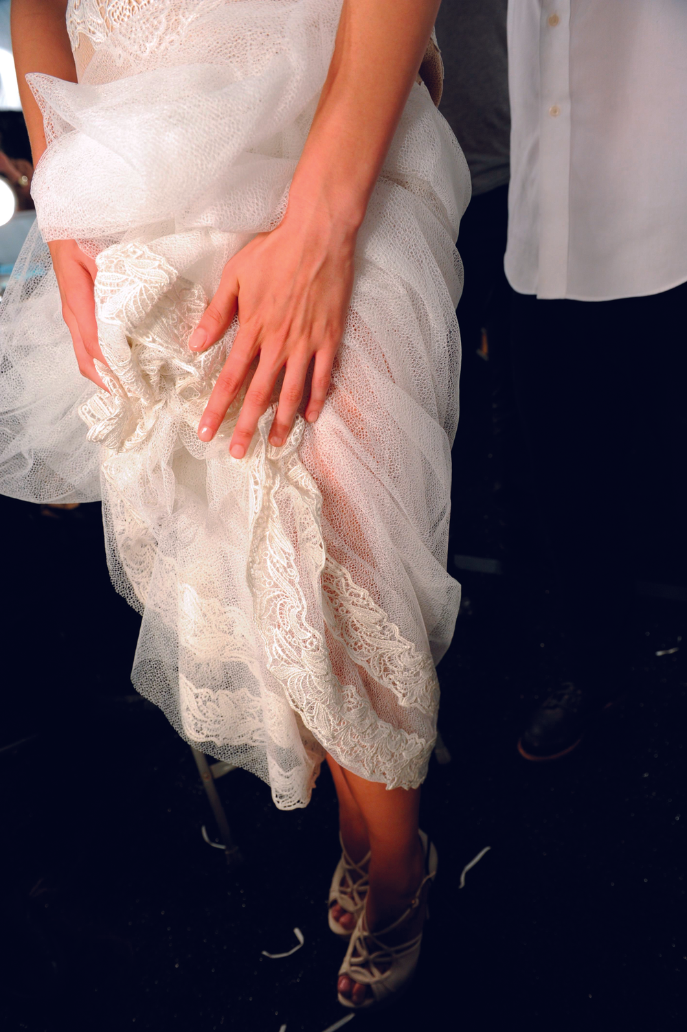 <p><strong>China Glaze</strong> Nude was used for manicures at the Tadashi Shoji (shown) and Porter Grey shows. At Tadashi Shoji, China Glaze Innocence was used on toes. The neutral shades accentuated the ethereal gowns for which Tadashi Shoji is known. The nail tech team was led by Josephine More, who was assisted by Danielle Candido, Lauren Baranowski, and&nbsp;Natalie Figorotta-Frank.</p> <p><em>Photography by Matthew Carasella</em></p>