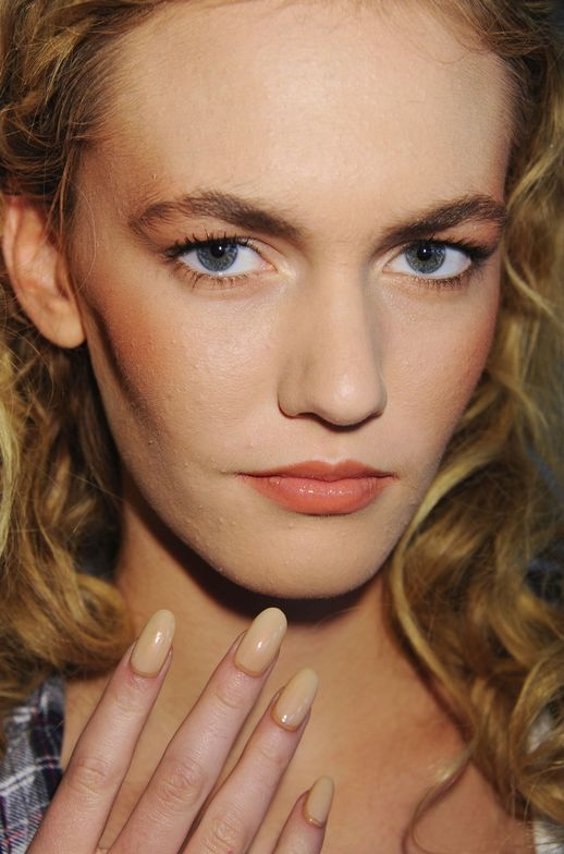 <p>At the Dean Quinn show, Wanda Ruiz used <strong>CND</strong> Copper Shimmer Effect topped with Putty and rimmed along the eponychium in Desert Suede to accessorize a &rsquo;70s-inspired collection of tangerine and mint pieces.</p> <p><em>Photo courtesy of Creative Nail Design (CND)</em></p>