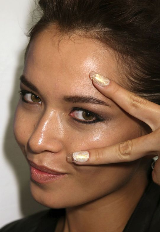 <p>At the Joanna Mastroianni show, nail tech Candice Manacchio used <strong>CND</strong> Desert Suede, Brilliant White, Ivory Coast, and Gold Shimmer Effect on the edges for an illuminated&nbsp;finish with texture. <em>Photo courtesy of Creative Nail Design (CND)</em></p>