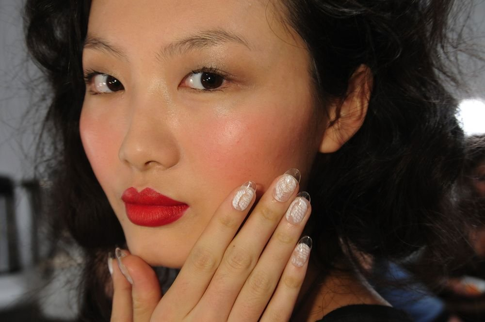 <p>At the Joy Cioci show, <strong>CND</strong>&rsquo;s Candice Manacchio used clear tips with hand-detailed lattice work that showed energy and attitude when paired with a fiery orange lip and frantic, whimsical curls.</p> <p><em>Photo courtesy of Creative Nail Design (CND)</em></p>