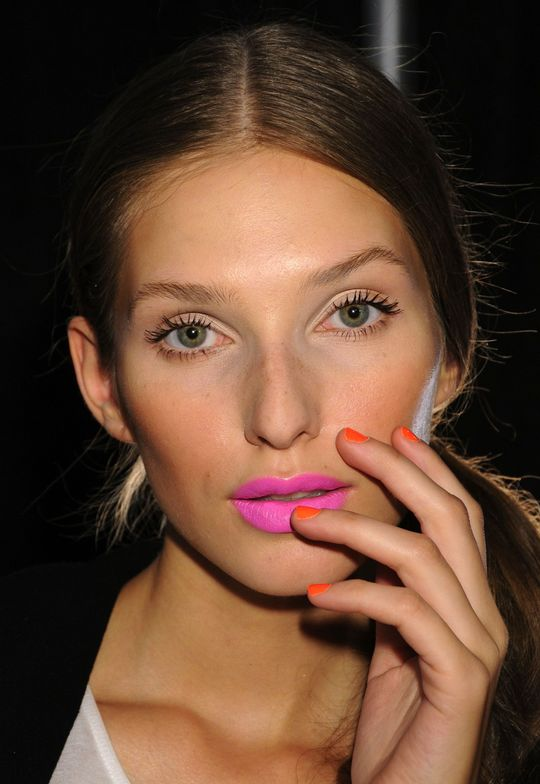<p>At the Milly show, nail tech Candice Manacchio created neon bright nails with a blend of <strong>CND</strong> Colours in Brilliant White, Bicycle Yellow, and Electric Orange to accessorize fuchsia pink lips.</p> <p><em>Photo courtesy of Creative Nail Design (CND)</em></p>