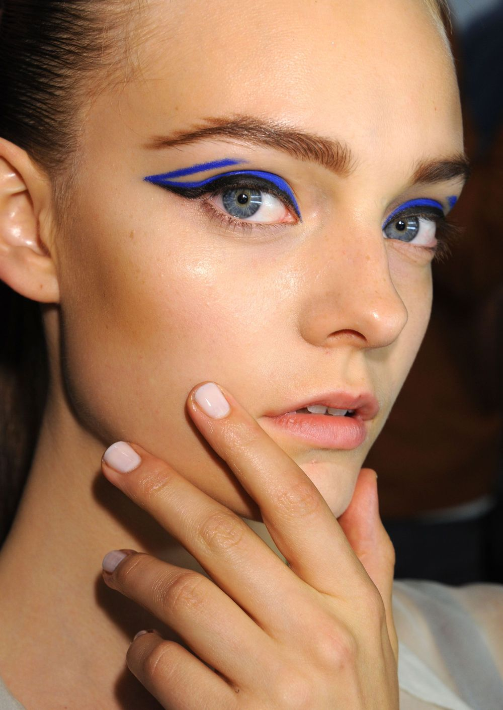 <p>At the Monique Lhuillier show, nail tech Wanda Ruiz and the <strong>CND</strong> team used Cream Washed topped with Super Shiney Top Coat for a glossy finish. The toes were reminiscent of a cloudy night sky with custom-blended blue.</p> <p><em>Photo courtesy of Creative Nail Design (CND)</em></p>
