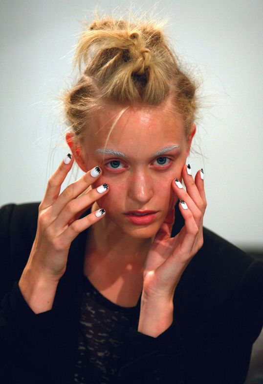 <p>At the Wayne show, <strong>CND</strong>&rsquo;s Wanda Ruiz used Brilliant White with feathered strokes of Blackjack on the tip of each nail to accessorize teased bird nest hair.</p> <p><em>Photo courtesy of Creative Nail Design (CND)</em></p>