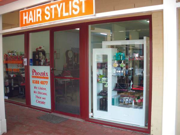 <p><strong>Phoenix Hairstylists, Balhannah, South Australia</strong><br />&ldquo;We have various OPI polishes and GHD hair products, some of my competition 3-D nail entries, and a few window clings (including for Shellac, lash grafting, and hair products). In the main window is me waving and working hand-in-hand with my clients and when people pass by they hear the happy chatter of clients and stylists working on hair and hands.&rdquo; &mdash; Monique Scott</p>