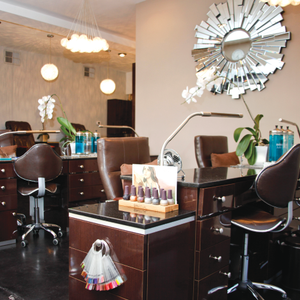 Blossom Beauty Lounge's sleek custom-built manicure stations help with organization by housing...