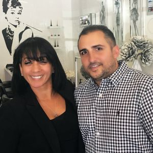 Anthony poses with salon owner Lori Cuevas.