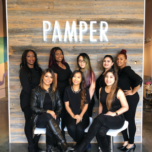 Xue (center back) poses with the Pamper techs, who went through a boot camp to perfect the craft...