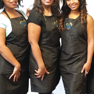 Trainer Khiana Block, Delane Sims, and assistant director Myeshia Jefferson pose for the camera.