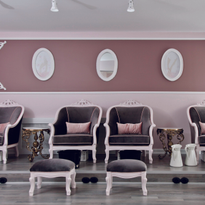 Located directly behind the manicure stations is the pedicure area, which seats four clients on...