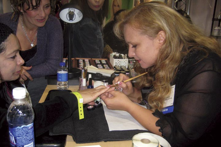 <p>Russian nail artist and AII&nbsp; educator Elena Maltseva had a constant crowd waiting to get a sample of one of her amazing designs. She placed first in the Veteran Handpainted Nail Art competition at the show.</p>