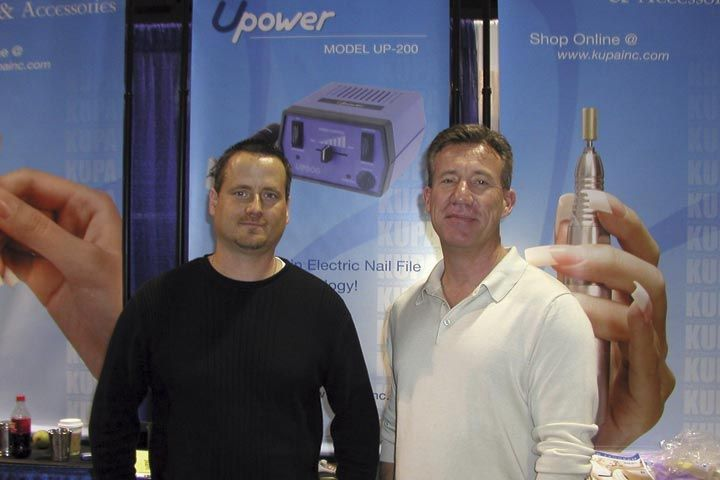 <p>Chris Stevens (left), sales manager, and Richard Hurter, marketing director, take a break from working the Kupa booth to pose for a snapshot.</p>