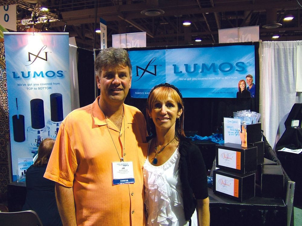 "<p><span style=""font-family: Whitney-Light; font-size: xx-small;""><span style=""font-family: Whitney-Light; font-size: xx-small;""><span lang=""EN""> <p align=""left"">Lumos founders Jim and Linda Nordstrom were working hard at their booth to educate attendees on the new Lumos top and bottom coats, with advanced formulas for faster dry times and improved performance.</p> </span></span></span></p>"