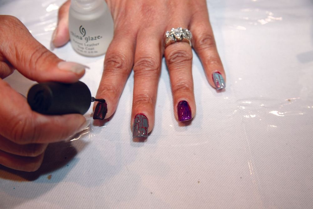<p>China Glaze educator Lynn Long demonstrates four of China Glaze&rsquo;s new Crackle Glaze colors over her previously polished nails (and gel-coated index finger).</p>