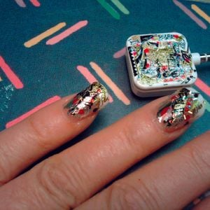 Pam Karousis of Nail Designs in Cortland, Ohio, is so enamored of her Square that she decorated...