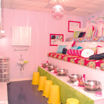 The Glo Girls pedicure area features theater style seating and cushy pillows for girls to lounge...
