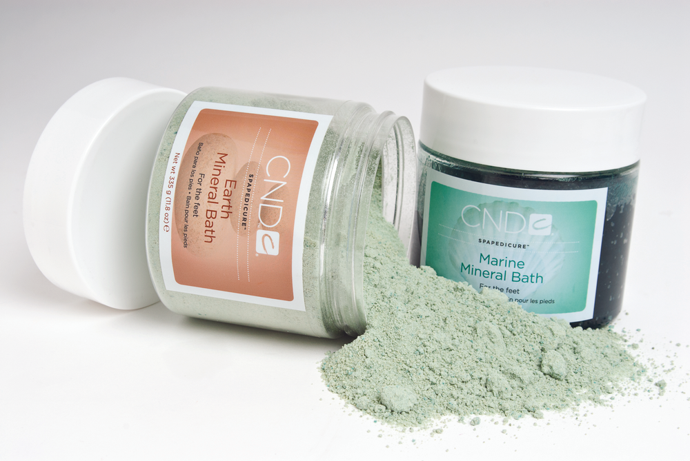 """<p><a href=""""http://www.cnd.com/Consumer.aspx"""">CND&rsquo;s</a> Earth Mineral Bath and Marine Mineral Bath soften and hydrate feet while natural fragrances provide aromatherapeutic benefits. The Earth Mineral Bath is a turquoise-hued effervescent made with citric acid, sandalwood and calendula oils, and malachite, a naturally occurring green mineral that converts to water-soluble copper to protect against free radicals. And the Marine Bath uses tea tree leaf oil, eucalyptus, sweet almond oil, and vitamin E to soothe the skin.</p>"""