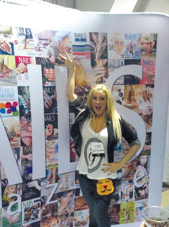 <p>Salon owner and reality TV star Katie Cazorla was excited to see the cover with her salon (and herself) on the NAILS booth.</p>