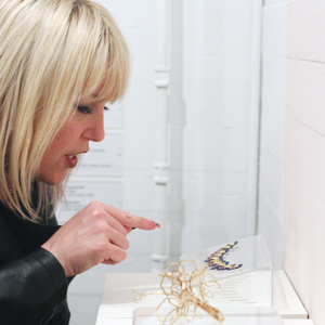 At the opening reception, gallery guests admired the interplay of the jewelry and nail art....