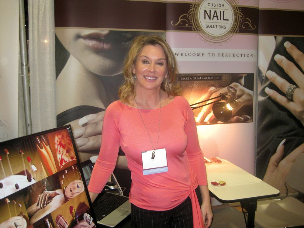 <p>Custom Nail Solutions founder/president Katie Saxton told attendees about how the company can make molds of clients&rsquo; nails to exactly fit their nail beds and last a lifetime, preventing the need for acrylic or gel application.</p>
