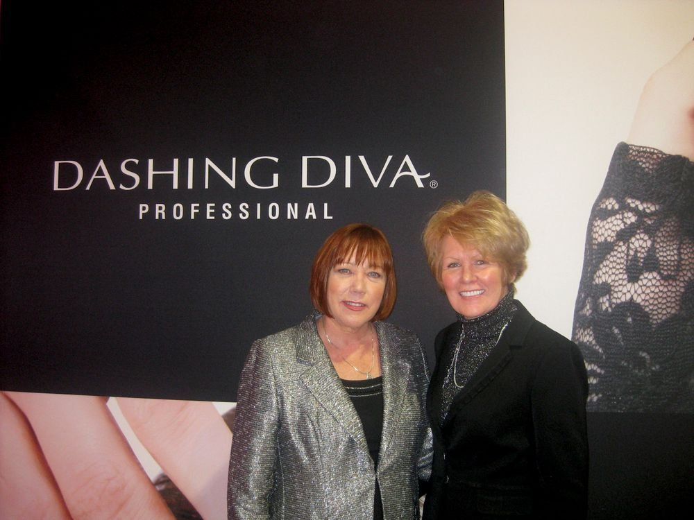 """<p>Nancy Waspi and Peggy Bellafiore told visitors to <a href=""""http://www.nailsmag.com/video/96134/isse-2013-checkerboard-nail-art-with-dashing-diva-colorfx"""">Dashing Diva&rsquo;s booth</a> about the company&rsquo;s line of products, including its nail appliques.</p>"""