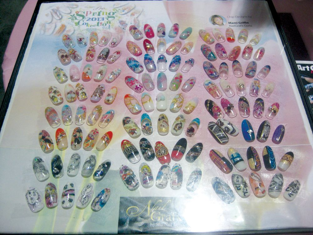 <p>NailGrafx guru Mami Griffin demonstrates the wide variety of nail looks that can be created using the company&rsquo;s decals, which work with a variety of mediums and can be layered with each other to create unique designs.</p>