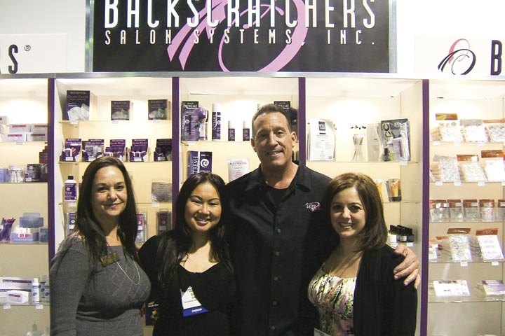 <p>The Backscratchers team had a great time at the show. Here the educators pose around CEO Michael Megna (left to right): Carol McCoy, Diana Snipe, and Christine Vargas.</p>