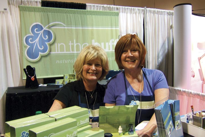 <p>New product In The Buff vice president Joyce Baker (left), and president Sunny Stinchcombe demoed their natural buffing cream kits. &ldquo;It&rsquo;s an old concept, but new technology,&rdquo; said Stinchcombe of the product, which brings natural nails to a high-shine.</p>