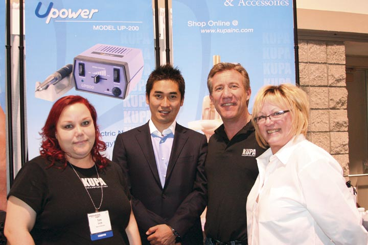 <p>Kupa&rsquo;s Sara Smith (left), Richard Hurter (second from right), and Vicki Peters (right) posed with Urawa Corporation sales manager Hirofumi Matsugi, whose company manufactures the Upower Cordless Electric File.</p>