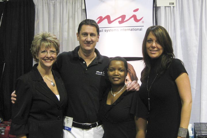 <p>From left to right, NSI&rsquo;s Marty Cooke, Rick Slack, Staci Noble, and Heather Hall pose for a snapshot in their booth.</p>