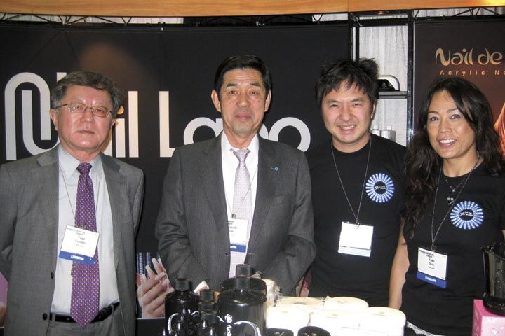 <p>From left to right, Nail Labo&rsquo;s Yuya Fujinami, Toshiaki Seki, Shinya Fujinami, and Yoko Ohno take a break from discussing the company&rsquo;s Presto LED Gels to pose for this picture.</p>