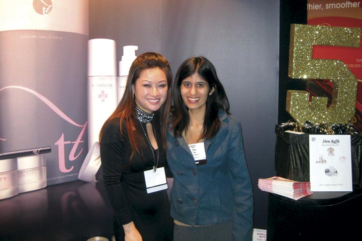 <p>Entity educator Cyndi Van and managing editor Sree Roy can&rsquo;t resist a shot by the sparkly &ldquo;5&rdquo; that graced Entity&rsquo;s trade show booth.</p>