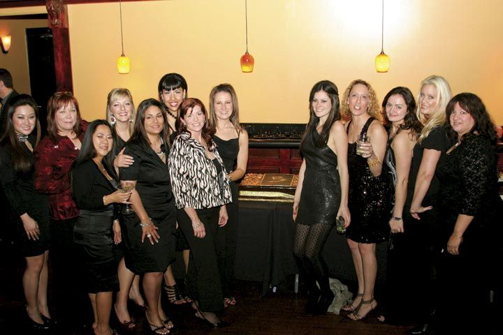 <p>Entity Beauty celebrated its fifth anniversary at the same beauty show where it launched its product line five years ago with a party at Club Cohiba. Some Entity employees and educators take a break from the dance floor to pose for this shot.</p>