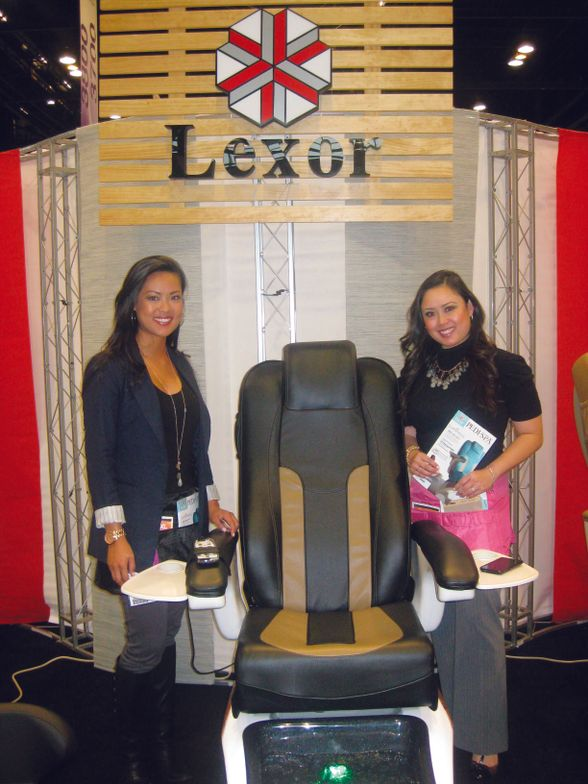 <p>Christine Nguyen and Jennifer Nguyen talked up the upgraded features of the improved Infinity chair, including stain- and acetone-resistant leather.</p>