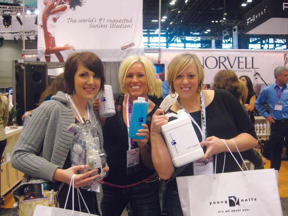 <p>Brittany Higdon, Summer Lovitt, and Sonja Larkin raided the Young Nails booth and were &ldquo;going back for more.&rdquo;</p>