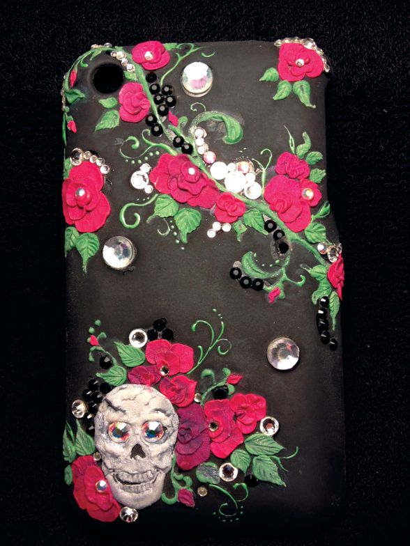 <p><strong>Hair Match Salon, Knoxville, Tenn.</strong><br />&nbsp;&ldquo;I did this phone cover for a friend of mine, Gaylein Ford, who is also a nail tech. It is 3-D acrylic and rhinestones. Some of the vines are gel paint.&rdquo; <strong>&mdash; Tammi Merritt</strong></p>