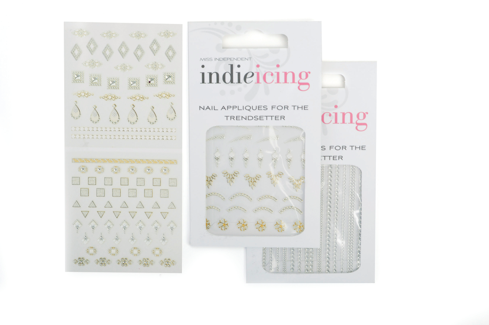 "<p>IndieGirl Indie Icing Nail Appliques are peel-and-stick decals that can be used with any lacquer, gel, or acrylic. The decals come in a variety of trendy designs. Eighteen varieties are available to choose from. <a href=""http://www.indiegirlbeauty.com"">www.indiegirlbeauty.com</a></p>"
