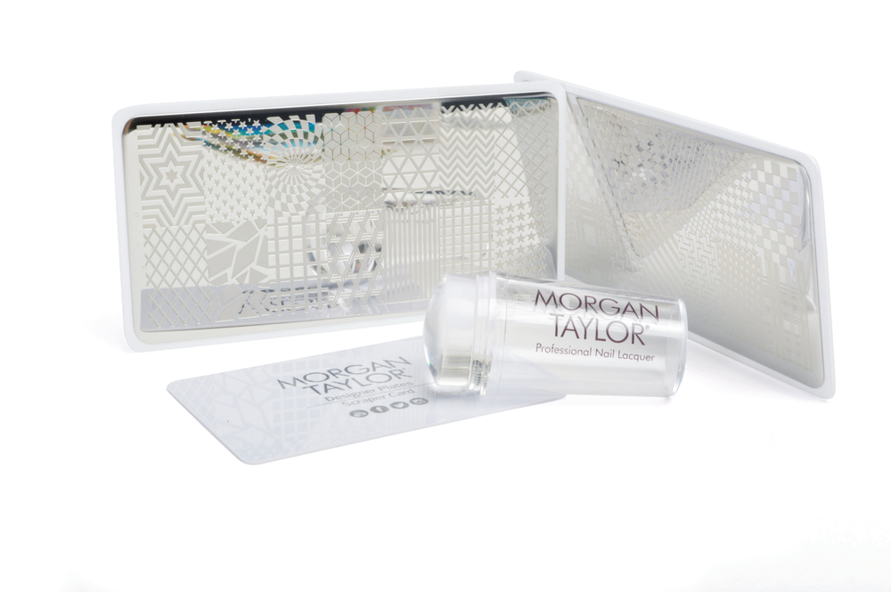 "<p>Put your stamp on next-level nail art with the Morgan Taylor Designer Plates Nail Art Stamping Kit. Available in Floral, Geometric, and Celebration-themed kits, Designer Plates give you the tools to create precise, detailed art every time.<br /><a href=""http://www.morgantaylorlacquer.com"">www.morgantaylorlacquer.com</a></p>"
