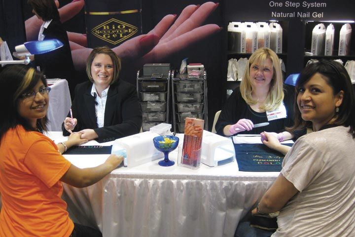 <p>Bio Sculpture educators Shannon Reed (left) and Kristin Worthington do demos on sisters Mirlym Milfort and Stephanie Santiago.</p>